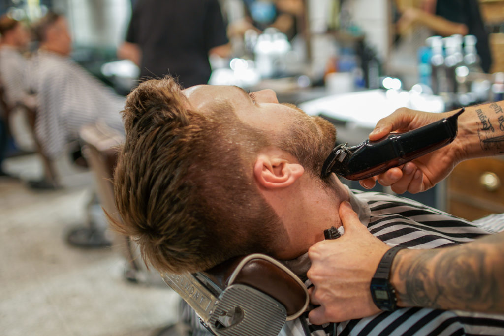 beard perfection se1; a barber trimming a client's beard
