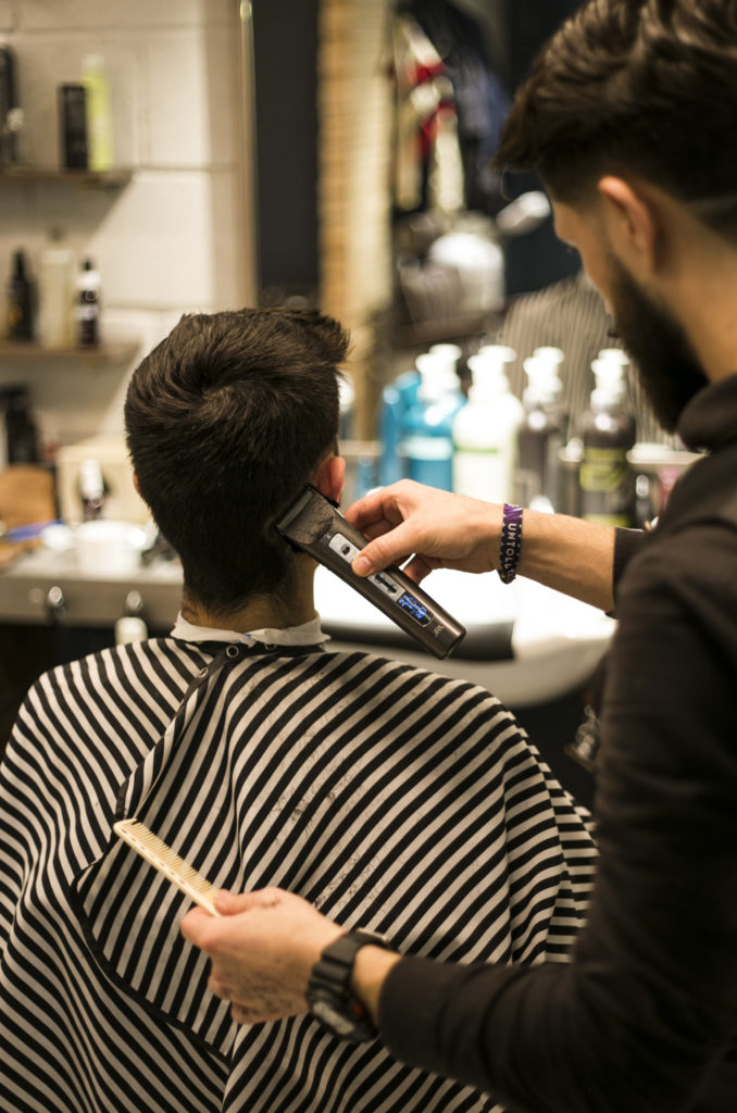 Southwark Barbers; a barber cutting hair of a client