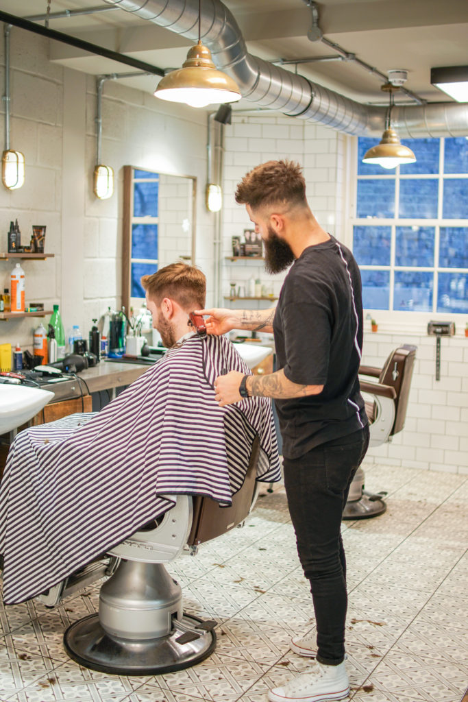 southwark barbers se1 restyle; a barber restyling a client's hair