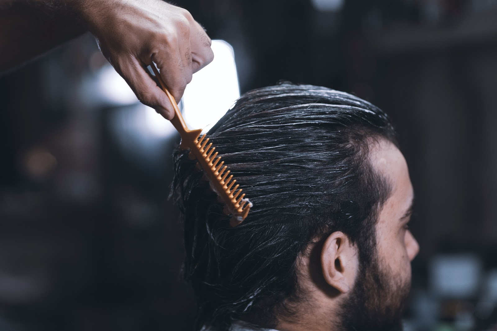Man getting hair combed